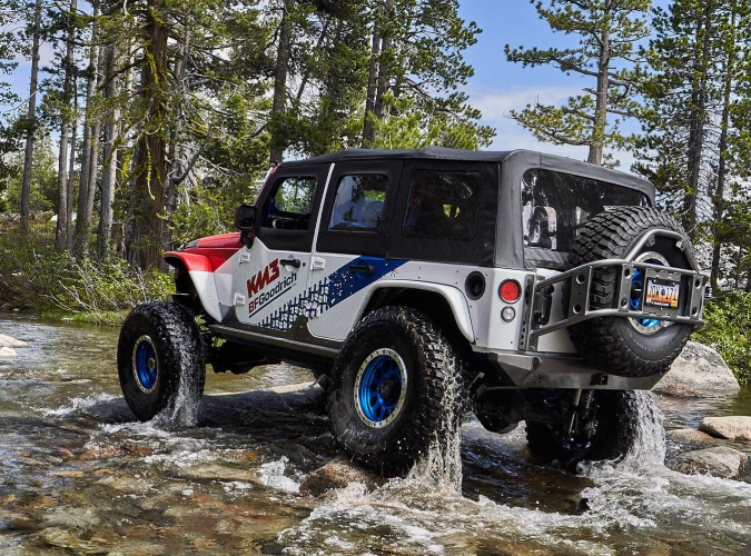 jeep driving in a creek