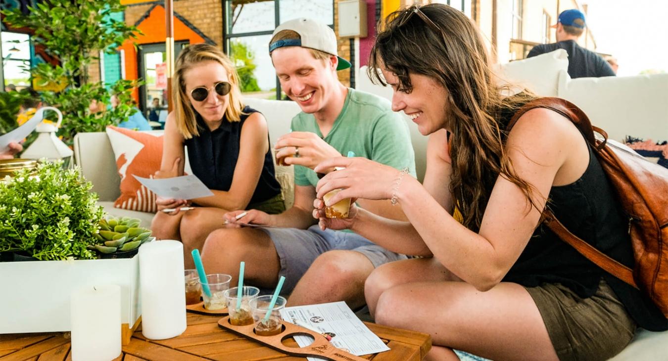 three millennials drinking coffee