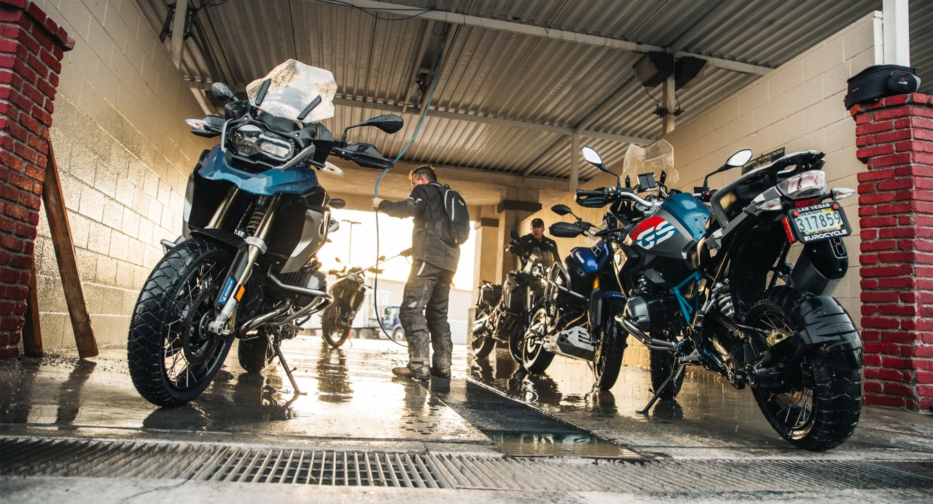 Motorcycles in a wash station