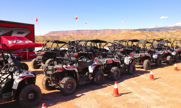 atvs lined up with flags attached