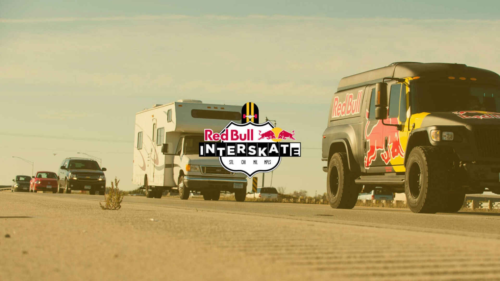 skaters caravan of vehicles with the red bull truck leading the way