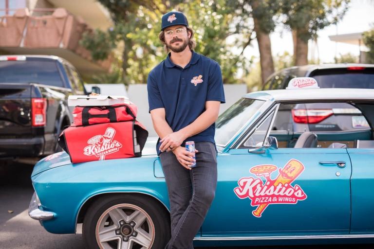 kris leaning against his prank car