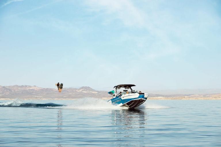 person wake boarding behind a supra boat