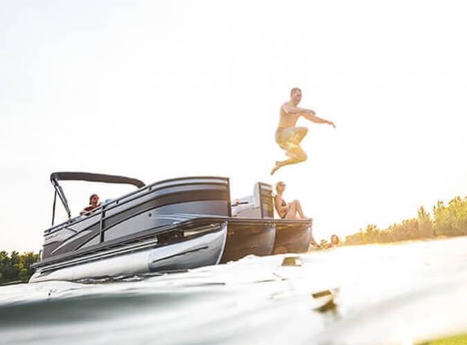 man jumping off pontoon