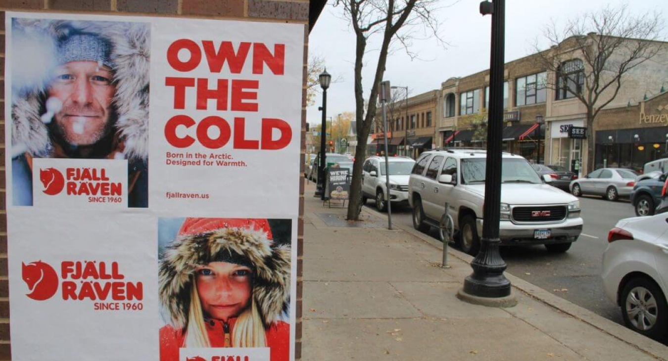 own the cold sign on brick building